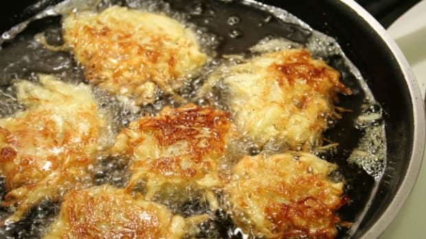 Potato latkes for Hanukah frying in oil.