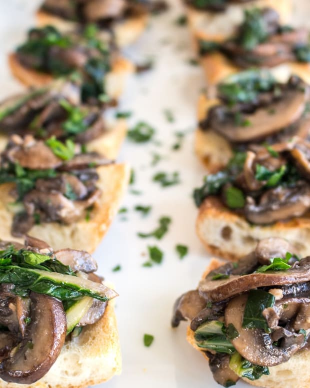 WILTED GREENS AND SAUTÉED MUSHROOM CROSTINI