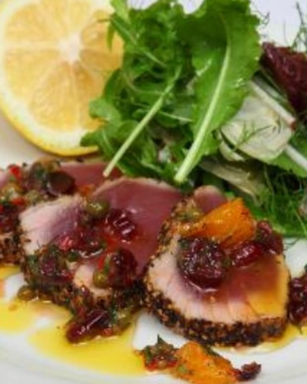 Seared peppered yellow fin tuna with dried cranberries, orange, chilli & dill