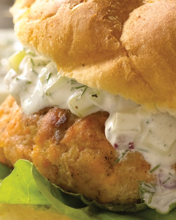 salmon burger patty with a cucumber dill sauce
