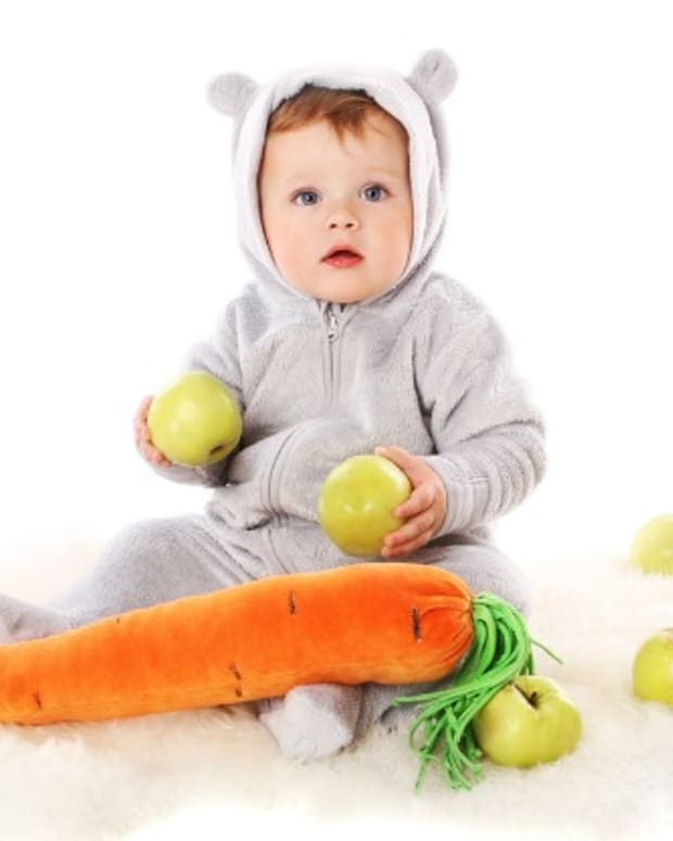 kid in costume with carrot