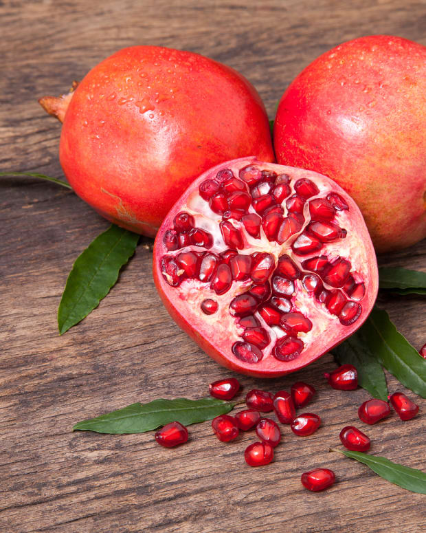 bigstock-Fresh-Pomegranate-Fruit-And-Po-148786013.jpg