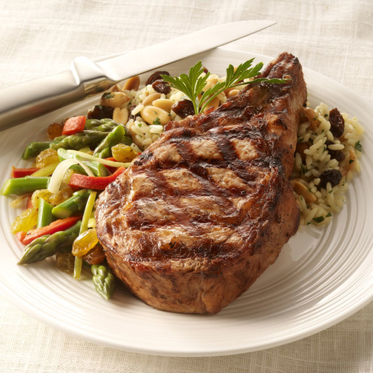 Grilled Veal Chop with Raisin-Rice Pilaf