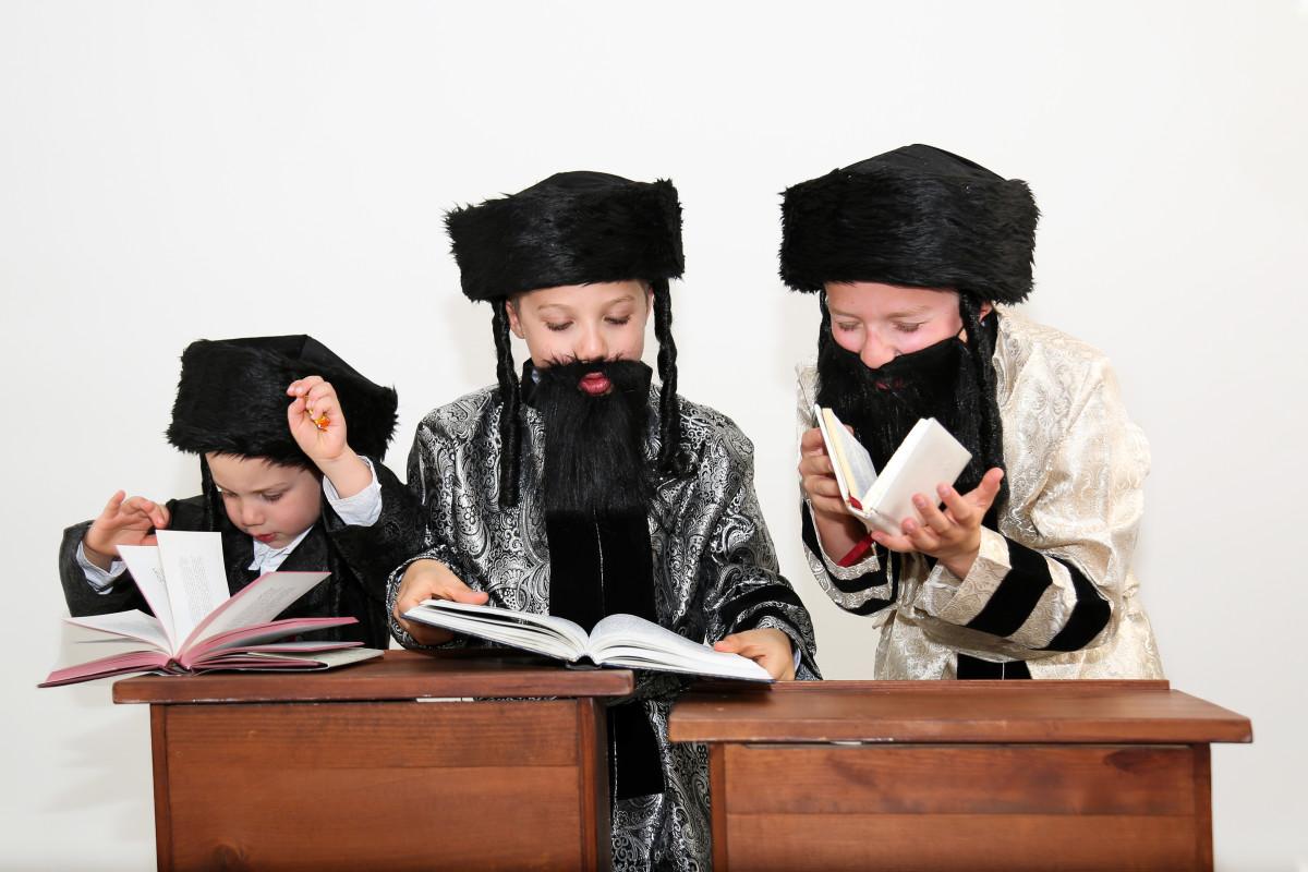 3 Boys Dressed as Chasidim Praying