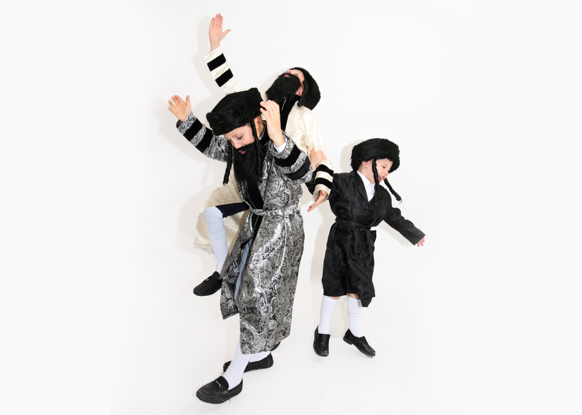 3 Boys Dressed as Chasidim Dancing