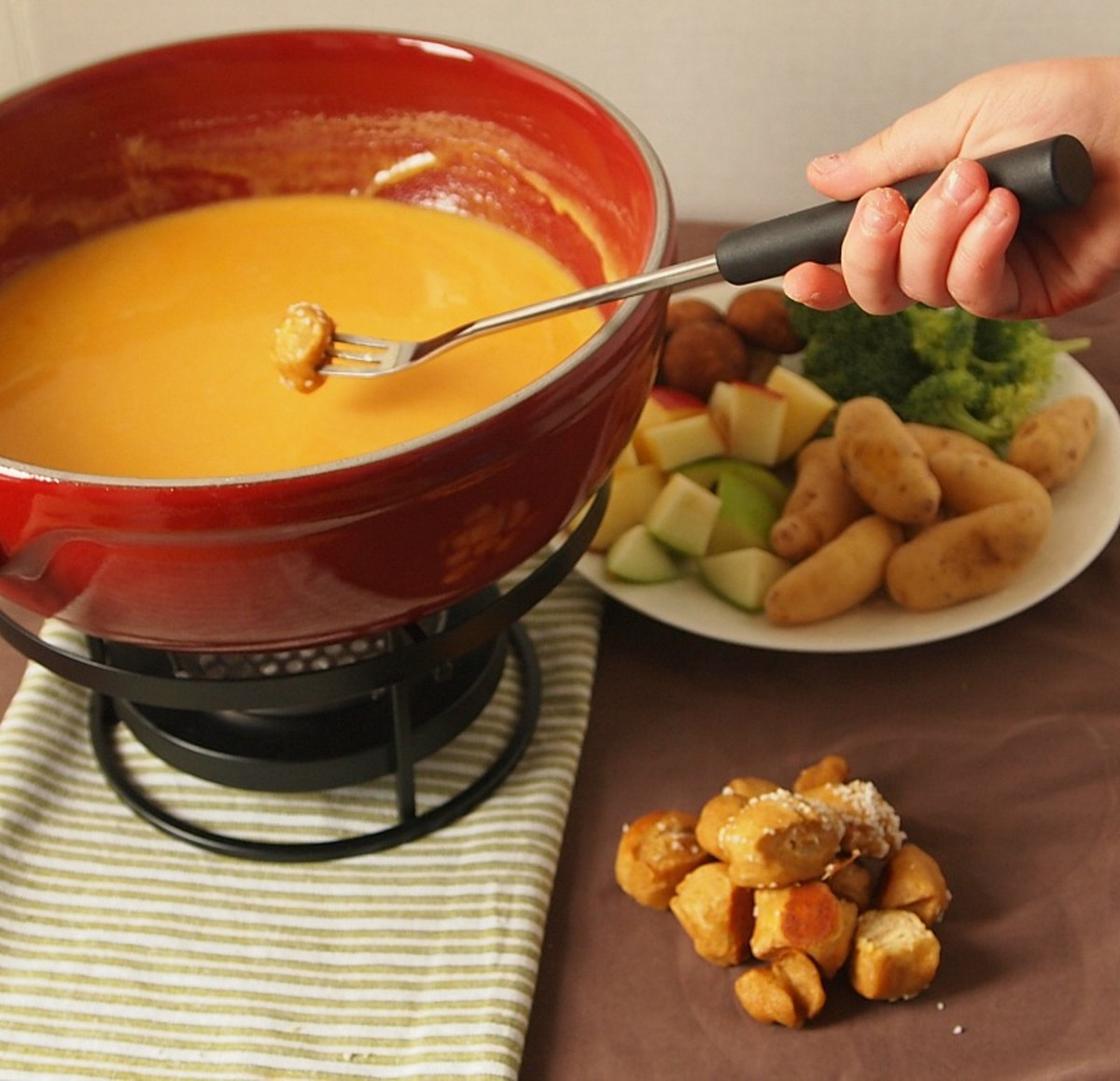 cheddar fondue with soft pretzels