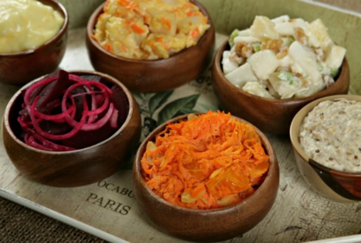 Mayonnaise, waldorf salad, red potato salad, eggplant babaganoush + orange carrot salad