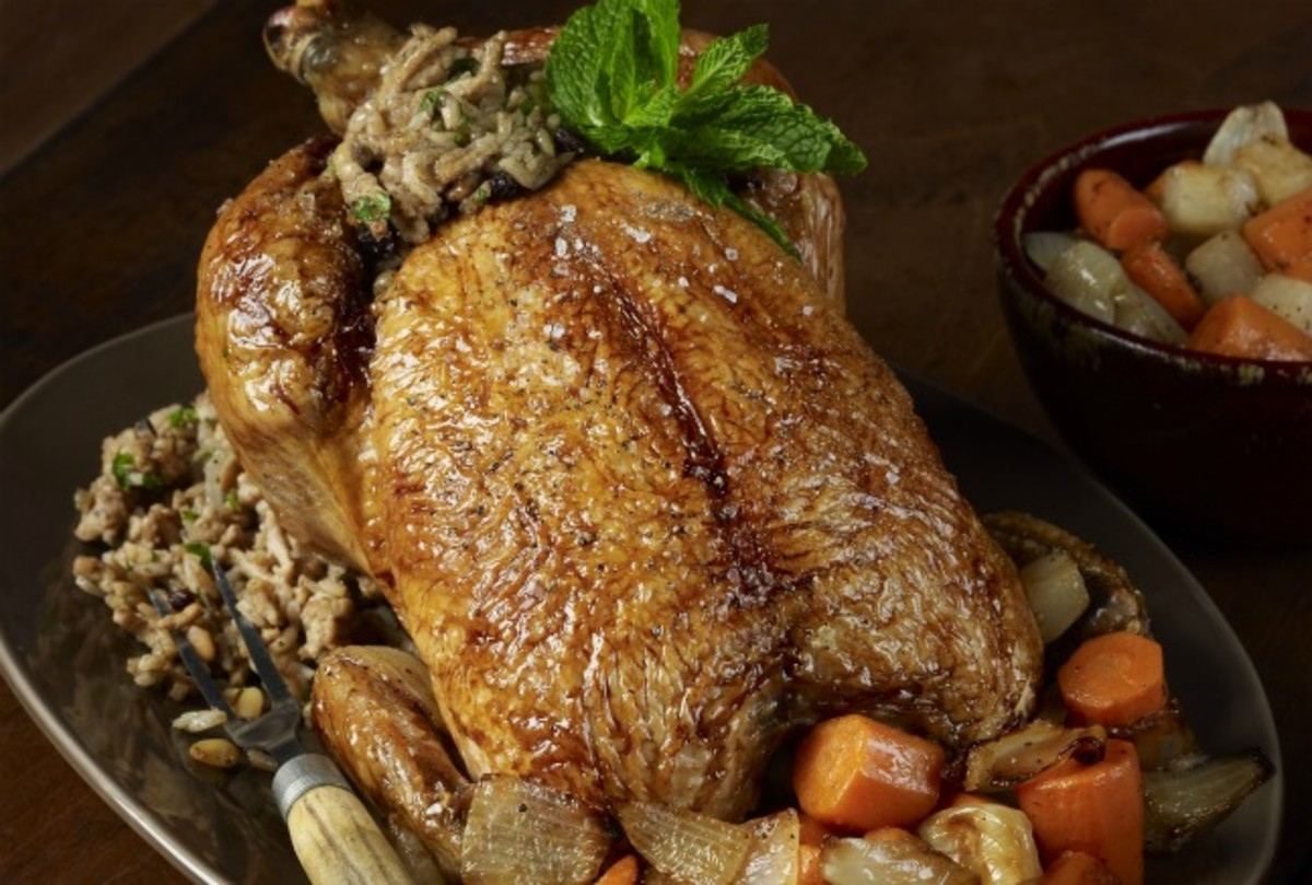 Middle Eastern Roasted Chicken with Rice, Currant, and Pine Nut Stuffing
