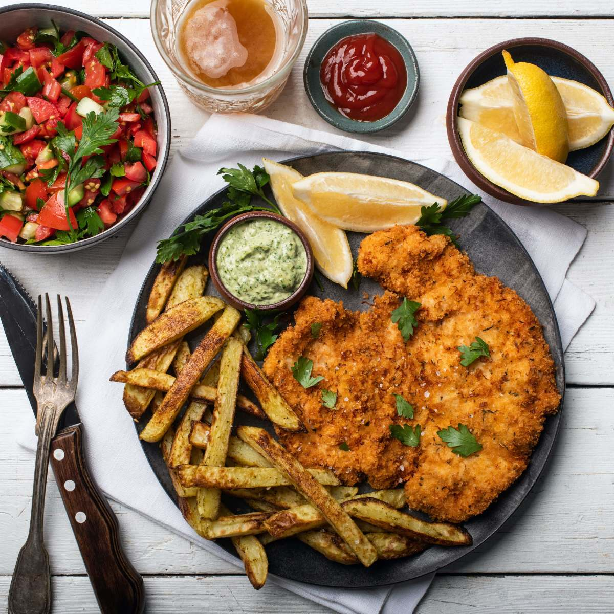 Crispy Schnitzel with Israeli Salad and Oven Fries