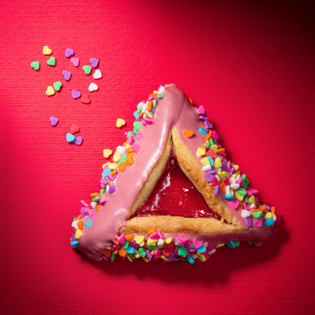Ruby chocolate dipped, candy heart covered hamantaschen