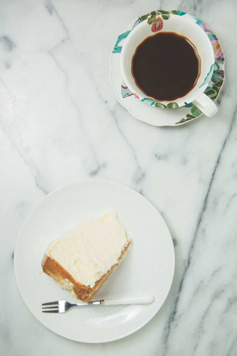 Slice of cheesecake with coffee