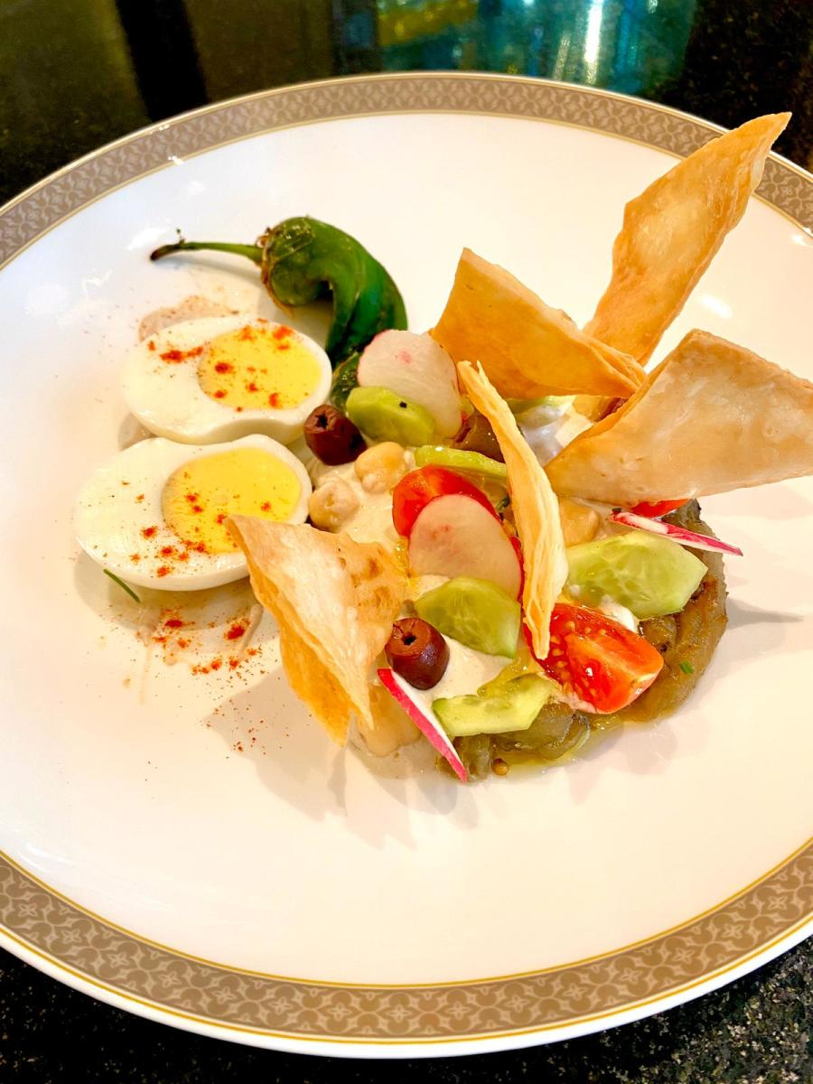 Sabich Salad smoked eggplant, tahini cream, hard- boiled egg, tomatoes, cucumber, chickpeas, harissa, crispy taboon bread